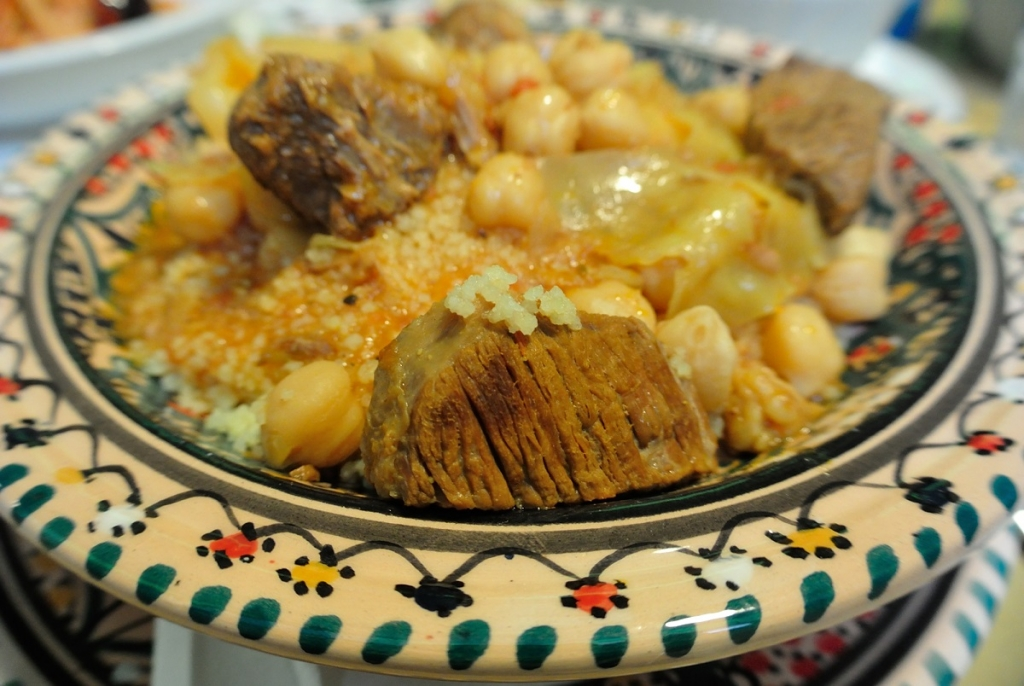 Couscous dish served on traditional Sicilian ceramic plate